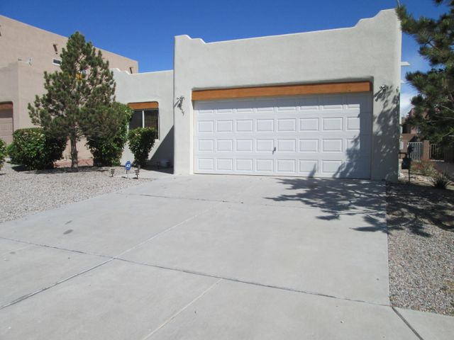 Freshly painted and ready to move into! Adorable one level pueblo style home.  Refrigerated air, surround sound, gas log fireplace, eat in kitchen.  OPEN FLOOR PLAN. Master bath has separate shower and garden tub.Great location, 5 minutes from access to I-40.