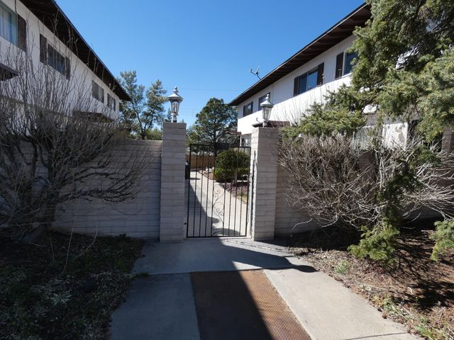 $275 a month HOA includes ALL UTILITIES.  No electric bill, no gas bill, no water bill and no trash bill!  Very cute 2 bedroom, 1.5 bath condo in a small 8 unit complex.  New cabinet doors and hardware in kitchen, new backsplash, new carpet, new blinds, all new paint, private back patio.  Frig, washer, dryer and built-in microwave included.  Furnace only two years young and water heater only one year young.  Plenty of parking!