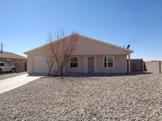 Super cute, remodeled house near UNM-VC.  This 3 bedroom, 2 bath house is adorable!  New paint, new flooring, new counter top, new fixtures, new appliances, new windows...  Over-sized 372 SF garage has epoxy floor and laundry hook-ups.  The back yard is fenced and has vehicle access.