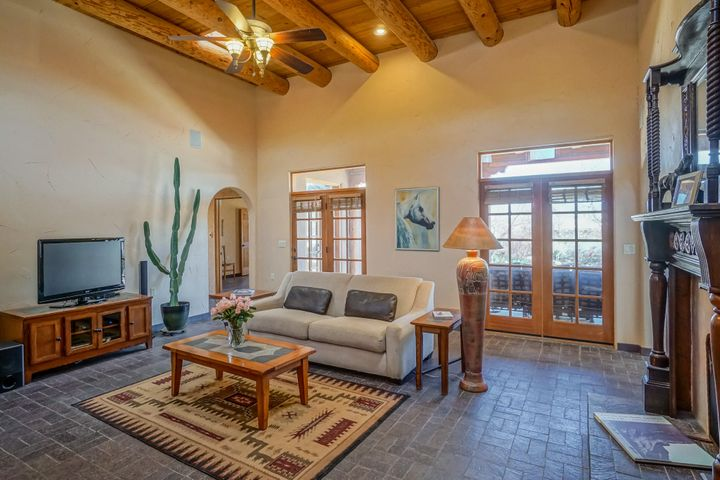 Open House Sat, Mar 23, 1-3pm. South End Corrales Character laden Santa Fe Style New Mexican Casa, high beamed ceilings, brick floors, light flooded row of French doors, corbels, hand carved doors, lighted nichos, adobe wall, antique gates, doors & vanities, diamond plaster two way kiva fireplace. Gourmet kitchen, 6 burner Wolf stove, pot filler, 4 seat breakfast bar, adjoining herb garden. Owner's Suite, kiva fireplace, 2 walk-in closets. 3 bedrooms with potential for 4th bedrm, office & large studio. Expansive East Courtyard is a verdant oasis of flowers, trees & bushes; the perfect setting for entertaining a grand event, even a ramada for the band! Perfect Horse set up; hay storage, tack room and wash rack. Raised bed gardens, fruit trees.Expansive adobe perimeter wall. Quiet cul de sac