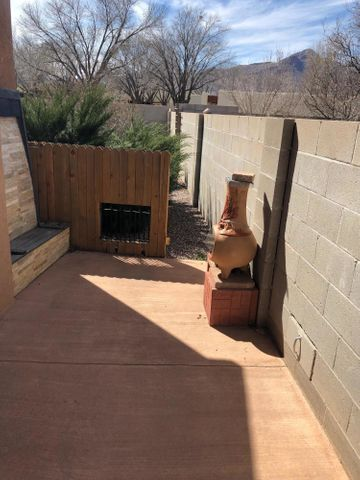 Close to New Mexico Tech...lots of upgrades in the two bedroom, 1 3/4 bath baths condo. granite countertops, laminate flooring , travertine fireplace front , lighting, fictures and a second patio... GFA, refrigerated air and a one car garage.