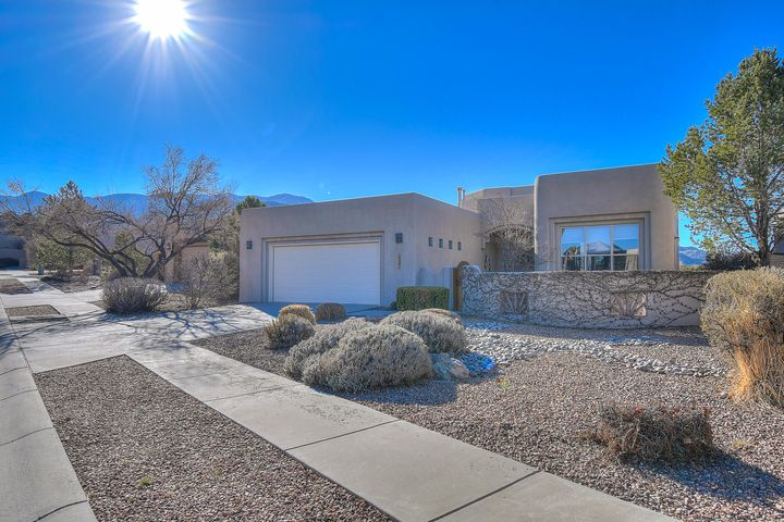 Welcome to this stunning Scott Patrick home with amazing views.  This former model home sits on a fantastic lot backing to open space, and has been well cared for by the original owner.  Beautiful great room with tall windows along a radius wall, and the large vigas add to the dramatic feel of this special home.  The kitchen features wonderful wood cabinets with ample storage, and there's plenty of counter space too.  There's a breakfast nook as well as a formal dining space.  Spacious master suite also offers great views, patio access, and a very nice master bath with tile surrounds and a large walk in closet.   You'll be able to enjoy not only the sweeping views of the Sandias, but also of the city lights and sunsets.  You'll feel at home the moment you walk through the door.