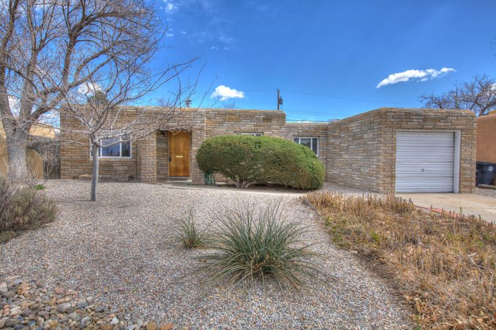 Fantastic well cared for gem in UNM area. Enjoy this single story 3 bedroom 1 bath home. Once inside enjoy the original hardwood floors, fresh paint. 2 living areas one with fireplace. spacious secondary bedrooms. Galley kitchen with stack-able washer and dryer. Big back yard some fruit trees and storage lots of potential to make this your oasis.