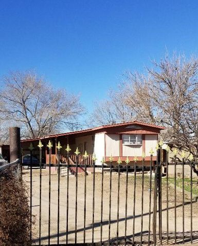 1/4 AC with MH Workshop Huge Open Patio with Carport and Deck! Enjoy the Views!BBQ  under the stars! With a dash of imagination this little place could be a Diamond! Charming Vintage 2 BR 1 bath with raised Kitchen and Retro Mirrors  and Wooden Overhang! Iron Accent separtes the Living area from the Raised Kitchen. Connect the Main structure to existing Outroom for a private living area or extra bedroom. ADDED VALUE-BRAND NEW FURNACE-BRAND NEW HOT WATER HEATER-BRAND NEW ELECTRIC POLE-BRAND NEW ELECTRIC METER! Bring your ideas, customize this home! Home being sold ''AS IS'' due to budgetary constraints. Corner Lot fully fenced with plenty of room for renovation! THISIS A 1978!