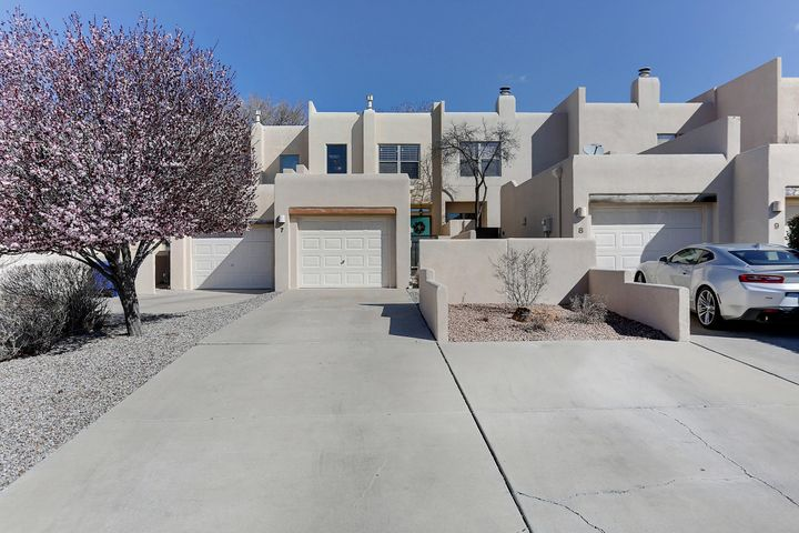 ***OPEN HOUSE Sunday, March 24th from 1PM - 3PM, if still available.*** Packed w/the WOW factor... This exceptional remodel will have you conveniently living minutes from everywhere you want to be. Special features incl: finished & insulated garage w/opener, durable synthetic stucco, energy-saving thermal windows, upscale re-done bathrooms, granite countertops, expensive new stainless steel appliances, durable new plank flooring, new carpet, all new lighting, relaxing and low-maintenance gas fireplace, low-maintenance grounds, convenient upstairs laundry... & TWO enormous master bdrms each w/their own baths & walk-in closets. Whether seeking a lock-&-leave for the traveler's lifestyle or simplified low-maintenance everyday living, you owe it to yourself to see this phenomenal home today!!!