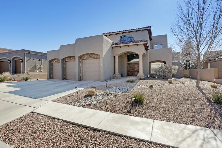 Gorgeous custom home in popular gated Ocotillo. Interior boasts tons of upgrades including surround sound throughout w/separate controls inevery room. Gourmet kitchen w/huge island, large pantry, stainless steel appliances, granite countertops and wine fridge overlooking huge great room w/tons ofwindows and built-ins. Spacious downstairs master suite w/luxurious bath and large walk in closet. Secondary downstairs bedroom w/attached bath is perfect for an office OR bedroom. Kids area upstairs w/2 bedrooms, bath and loft. Spectacular mountain and city views from upstairs deck. Enjoy the quaint sunroom all year long! Backyard is easy to maintain with top of line turf, even includes a putting green. Oversized 3 car garage w/bonus heated workshop/dog area with side yard access.