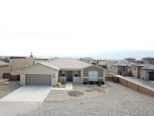 Don't miss your chance to call this beautiful, 3 yr old, Rio Rancho Estates gem, your home.  This Twilight home boasts a  well designed  floor plan with fabulous views of the Sandias,  and a gorgeous kitchen, which opens up to the living and dining area,  the perfect home for entertaining.  The kitchen has granite counters, stainless steel appliances, large breakfast bar/island, 9' X 4'. and a custom vaulted Sky chase skylight over the island.  The over sized master suite has a dbl vanity, tile wrap around tub, and walk in shower.  Enjoy the stunning views of the Sandia Mountains, and beautiful New Mexico weather in the backyard, which has a 10' X 10'' covered patio and freshly poured 32' X 29'' patio.  The backyard is a blank canvas waiting for you to make it your own!  It won't last long