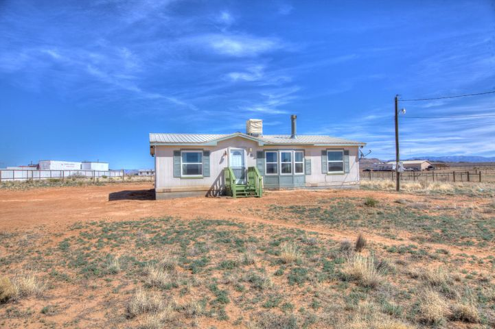 Fantastic opportunity to purchase a home in the big Los Lunas Boom!! Enjoy this well maintained Manufactured home situated on 1.67 acres completely fenced property with dog kennel that's buried a foot under ground. Enjoy stunning mountain views from your outside deck. Floor plan is open light and bright. Horses are welcome! Easy access to Albuquerque.  This property is perfect for people wanting country living. Close to I-25. Make offer today.