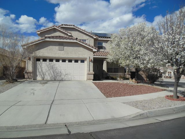 Write your family's story in Story Rock! Quiet, quality area nestled at the base of the petroglyphs with community park.  Cool refrigerated A/C. Save $$$ with new solar panels, tile roof. Dramatic arched  accents. Huge master suite, big walk-in closet & spacious bath, separate garden tub.  3 Living areas, 2 main level & loft with view balcony upstairs.  Let the sun shine in these large bright windows in open-concept living.  Loft & upper open to lower space.  All new stainless appliances including convection oven, gas cooktop stove, microwave.  Big walk-in pantry, breakfast bar and nook, plus formal dining room.  Laminate & tile floors grace the main level.  3 upper bedrooms with a 4th down with double door entry, would make a great office.   Corner lot, covered patio with extended pavers.