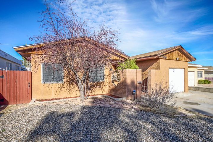MOVE-IN READY! Spacious and open floorplan, this home has great characteristics.  Tile Floors. Upstairs 438 sq ft Bedroom Loft has a Full Bath. Finished Garage, large heated Sunroom.  Great workshop out back and room for a garden.
