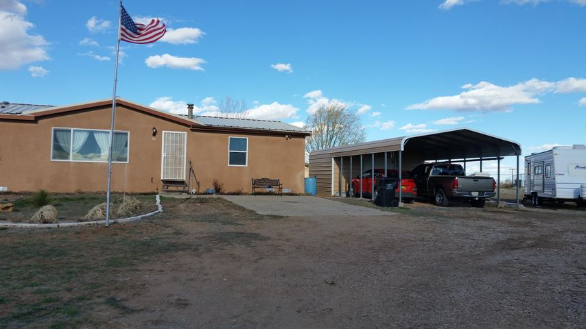 Spacious 4 bedroom fully updated manufactured home. Metal Roof, Upgraded Windows and Doors, Stucco, Carport with Storage additional Tuff Shed, Stalls and fully fenced make this a great country home. Close to shopping, Restaurants, and Medical facilities. 20 Minutes to Tramway and I-40 makes this a great commute to Albuquerque. Or to Santa Fe via the Park and Ride which commutes daily just 1.5 miles down the road. Natural Gas and EPCOR Water make this home easy to own. Deactivated Title and approved foundation eligible for FHA loan.