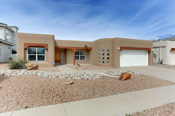 Lovely Contemporary Southwest Style Home In A Great NE Heights Cul-De-Sac Location! * Single Story with an Open Floor Plan * Soaring Beamed Ceilings in the Great Room with a Kiva Fireplace * Gorgeous Updated Kitchen Designed for Cooking! * Large Island, Granite Counters, and a Six Burner Gas Range with Hood * Separate Dining Room * Carved Wood Posts * Master Suite on One Wing with Spacious Master Bathroom Including Updated Shower and Vanity and a Separate Tub * Large Walk-In Closet with Built-Ins * Two Additional Bedrooms Share a Large Bath * Covered Patio and Landscaped Yard Including Planter Beds * Refrigerated AC * Neighborhood Shopping Including Trader Joe's Just a Few Blocks Away * Two Car Garage * Parks and Walking Trails * Dennis Chavez/Desert Ridge/La Cueva * This One's a Keeper!
