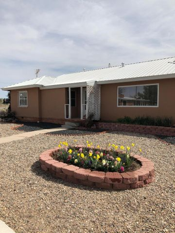 Don't miss out on this beautiful home!! This property is unique and sits on a  double lot this home has  beautiful curb appeal with it being a corner lot and offers over 2,200 sq. ft. This amazing property will also SAVE YOU MONEY due to the solar panels on the home....Complete with 3-4 bedrooms large open kitchen and 3 living areas perfect for entertaining.....Don't overlook. Call Today!