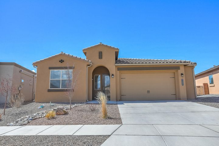 Beautiful Single Level Home in Valle Prado Subdivision!  Almost brand new.  Built 2017.   Featuring a lovely entry way, 2 1/2 car garage, leaded glass 8 foot entry door, granite countertops, 7x20 wood plank tile, stainless steel appliances, refrigerated air, recessed lighting, tile surrounds in bathrooms, and much more!  Build Green NM and Certified.  Award winning DR Horton Lawrence floorplan. Backyard is spacious & fully landscaped with a covered patio.  Don't miss out on this amazing deal!  It's the perfect place to hang your heart!  Conveniently located near schools & parks.