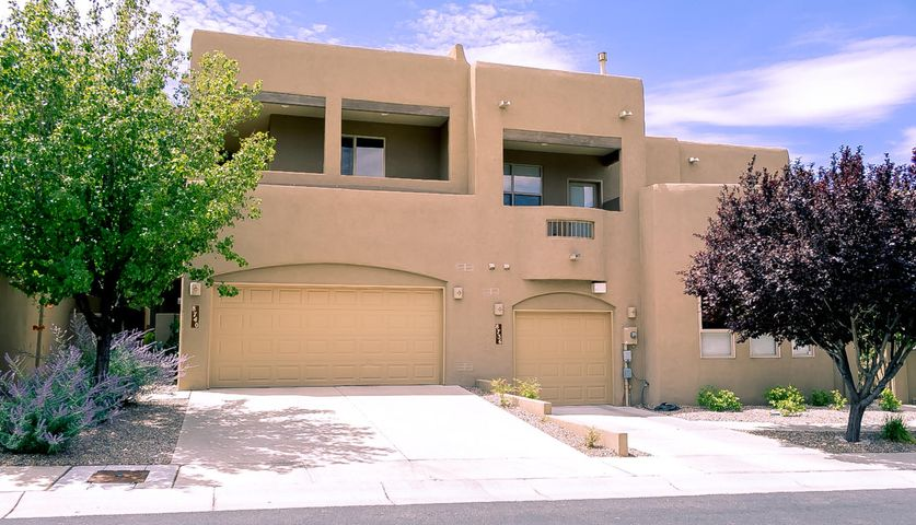 This well maintained home with many custom upgrades and magnificent views is located in the Desert Ridge Gated Community. This very open & spacious floor plan is great for indoor & outdoor entertaining. High Beam ceiling, new windows and gas log fireplace in living room.  Gorgeous kitchen with beautiful countertops & stainless steel appliances & upgraded gas grill oven. Large laundry room with  lots of built in storage. Master Suite has private covered balcony, luxurious master bath & large walk in closet. The SW landscape allows for easier maintenance, gated backyard access from front porch thru nice side yard path. Half bath on the main floor. The upper level has 3 bedrooms w/ walk in closets & extra storage. Relax on the second floor spacious covered balcony w mountain views.