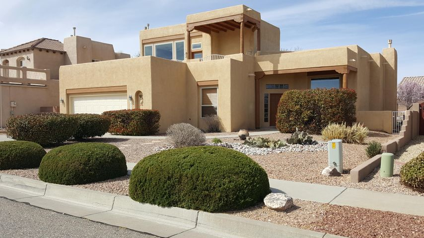OPEN HOUSE SAT 4/13 & SUN 3/14 12-4PM. Enjoy breathtaking views of the Sandia & Monzano mountains, Petroglyphs, city lights & sunsets. Custom home is replete with 7 skylights, nichos, corbels & vigas. Master bedroom on  main level has double sinks, jacuzzi tub & huge walk-in closet. Beautiful engineered floors have been  added to the living & dining rooms and Master BR.  Spacious kitchen has granite counter tops, new DW, beautiful back-splash, an island & large dining area. Open downstairs living area  great for entertaining inside & easily flows to the great covered patio in the inviting  private BY.   Great loft w/wet bar opens to expansive upper deck to enjoy those incredible views! BY is xeriscaped, with grass, mature trees and a water fountain.  All landscape on sprinklers or drip.