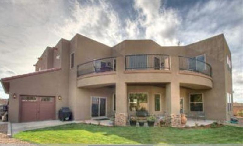 Meticulous custom home with cozy nooks and open spaces! Impressive hand-wrought iron entry door *Faux/designer paint through out, *Faux copper dining room ceiling,  *Top-line S/S appliances, granite, solid/staggered 42 inch cabs in kit. *City/mountain views from the expansive front & back upper balconies, huge covered portal*H/W floors through out upper level, *Beautiful radiant heat stone covers the 1st floor, Pitch and Put artificial turf in back,*GIANT 4 car drive-thru garage w/xtra storage! *Walk-in closets in each bedroom, *Awesome, private Master suite w/beautiful bath & 3-way FP, *LR has 22' ceiling with built-in automatic shades, stone accents & wine bar, *Formal dining room built-in 4 inch wooden blinds, *Quiet cul-de-sac with opening to paved walking trail* Must see!