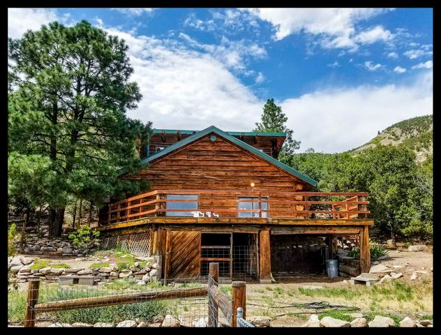 Absolutely stunning custom log home nestled in 132 Acres of tree filled mountain paradise providing privacy, amazing views, and hiking/wildlife from your front door! Home boasts lots of upgrades and luxurious amenities along with rare adobe/cabin charm and warmth that you will fall in love with! Truly the perfect retreat to call home that's only 10-15 minutes away from Wal-mart, schools, shopping, dining, and only 30-40 min drive to central Albuquerque too! 3 bed, 3 total bath, upgraded kitchen, flooring, bathroom,  18''+ custom logs from Chama provide amazing insulation R27 equivalent, Hurd windows, 2 car garage, and an amazing deck with Million $ Views! 3Dtour: https://goo.gl/deFqwK $5,000 Personalization Allowance Negotiable! REC/Owner Financing possiblePRICED TO SELL FAST!!!