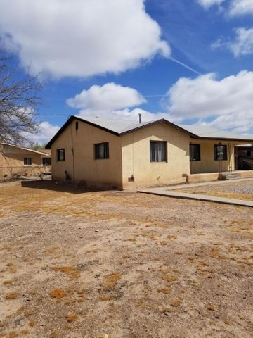 Nice house in Los Ranchos on a .41 ac corner lot. Property is being sold as is.