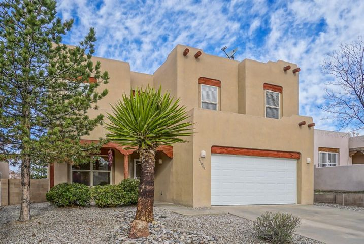 Surround yourself with elegant New Mexico style!  Newer carpet & tile throughout. Stunning formal living room with beamed ceiling, vigas, cozy gas log kiva fireplace, built-in entertainment center w/plant ledges, unique glass block/latillas accents & backyard view. Formal dining room w/Tiffany style lighting & custom shelving unit.  Chef's kitchen is open to living room, has granite counters, ample cabinet space plus pantry, stainless appliances plus breakfast nook.  Master suite has private balcony w/sunset views, fully updated bathroom w/garden tub, dual sinks, granite counter, mosaic accents & 8x8 walk-in closet w/organized storage system.  Front Bdrms have mountain views! Beautifully landscaped EZ maintenance yard w/bubble drip, xeriscaping & stunning SW style gazebo. Oversized garage.