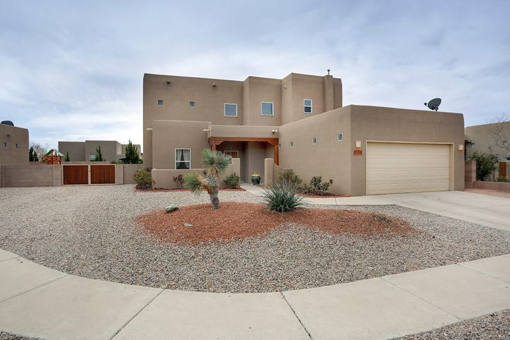 Roses are Red, Gardens have Gnomes, come out today, to see Your New Home!! You will Love this Custom Modern Pueblo Home completely ready for Your Move-In. This Home features SW Style Wood Beams, Custom Tile Flooring, Tile Enclosed Baths and Shower, Stainless Steel Appliances, Walk-In Pantry, Ceiling Fans, Raised Ceilings, Refrigerated Air and 2, yes 2 Kiva Style Fireplaces. Sitting on one of the more spacious lots in the neighborhood, you will enjoy the Fully Landscaped Backyard that includes Grass, a Covered Porch, An Upstairs Deck with Views, and SIDE YARD ACCESS.  Schedule your showing today!!!