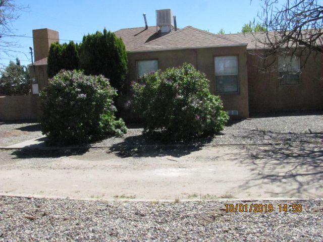 Location, location, location.  Two/three bedroom, one bath. New stucco, original hardwood floors refinished, new roof,.  Walking distance to Rio Grande Nature Center, --biking, nature walks along bosque trails.  Close to natural foods co-op.