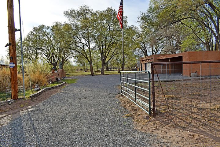 Take a step back in time in this beautiful home resting on 2.21 acres all fenced with gates for privacy, covered patio and an outside kitchen. Irrigation is available, great property for horses.