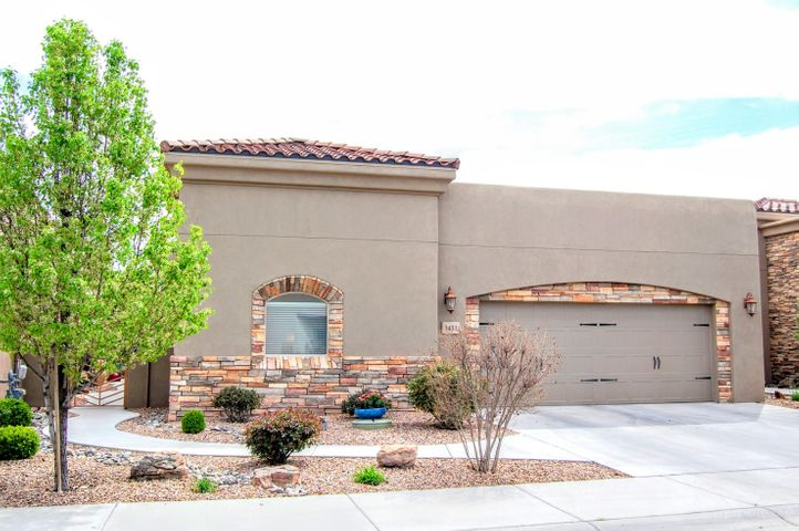 Come see this Stunning single-story custom home with elegant upgrades & amenities. It's in a desirable gated community in the heart of the North Valley! This home features an open floor plan with 10' ceilings, plaster wall finishes, custom alder doors, skylights & stacked stone gas FP. Kitchen has custom cabinets, granite countertops, SS appliances, pantry & breakfast bar. There are wood floors throughout with tile in bathrooms & laundry room. The Two Master Suites each have a master bath. Laundry room has custom cabinets, granite countertops & a sink. High Efficiency Combo Unit/Refrigerated Air. 2''X6'' exterior walls including the garage. Pre-wired for security system & smart home. Lovely private quiet courtyard leading to the beautifully landscaped backyard with a water feature.
