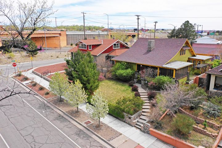 Price Reduction... Possibly the Best  Arts and Crafts Bungalows in Albuquerque. On the National Historic Registry.  Original woodwork, flooring, and era correct lighting fixtures throughout. 3 bedrooms ( master suite upstairs) plus office. 2 full baths. Stunning Living/ Dining room with River Rock fireplace.  Large Modern Kitchen with eating area. Wrap-around screen porch looks over Highland Park. Expertly Restored. Updated electrical and plumbing. Central Forced Air Heating and Refrigerated Air.  Wooden Storm windows. Oversized 2 car garage w/ work area (or 3rd car if smaller.) Beautiful easy care landscaping with outdoor living spaces and stone fireplace.  Conveniently located near Hospitals, University, Downtown, and Airport.  A MUST-SEE PROPERTY!