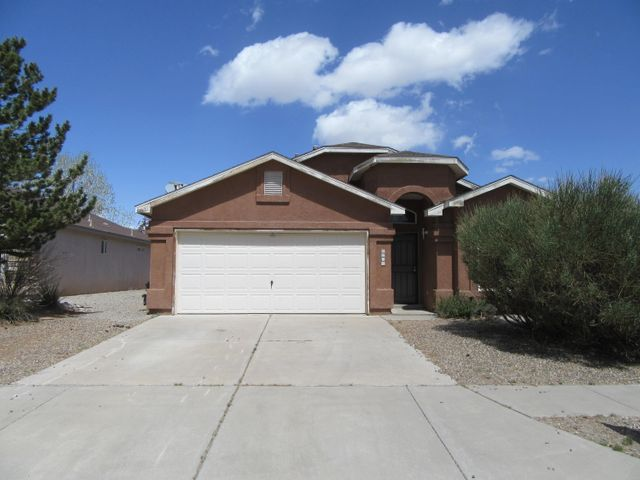 Spacious and open 4 bedroom, 2 bathroom home on a corner lot in the desirable NW area of Albuquerque.  Features and open floor plan with vaulted ceilings a large master suite, garden tub, generous walk in closet, 2 car garage and covered patio.  Needs a little TLC but home has great potential at a great price.  Won't last long come take a look today.
