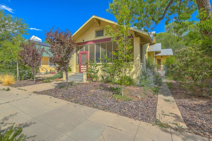 Unique historic craftsman home surrounded by many of the most majestic historic homes in Albuquerque. Filled with original features, classic  charm, and contemporary functionality. Enjoy the natural light brought in by the original leaded glass panel windows with original massive wooden frames. Gorgeous views of the the huge, private, fully-fenced lush backyard complete with garden area and 2 storage units. Interior highlights include a screened porch with period swing, over-sized living room with Art Nouveau style fireplace, charming powder room, formal dining room, and hardwood floors throughout. The huge designer kitchen offers vast counter space, tons of storage, farmhouse sink and professional range. Very desirable location convenient to all downtown amenities!