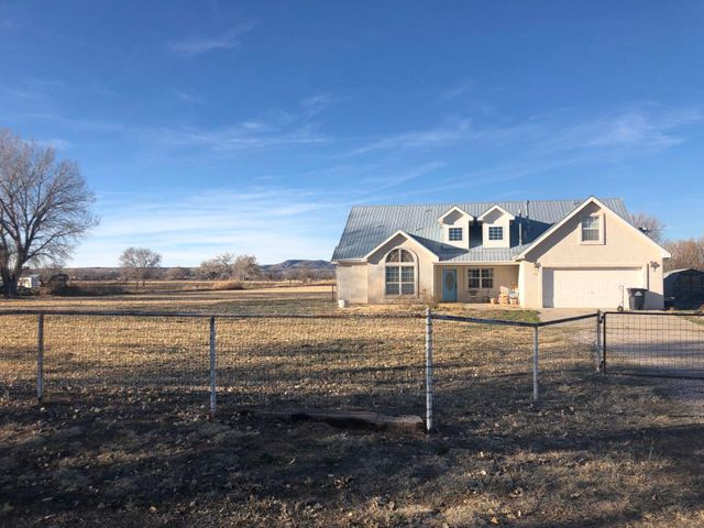 Custom built home on 2.8 Acres. Bring the animals to this pieceful oasis in the country.  Large kitchen with plenty of cabinet and counter top space. This home has 2 Master Suites, one upstairs and one on main floor.  There is 2 additional rooms that can be games rooms, office, hobby room, etc. Garage is insulated and finsihed. Covered patio for the outdoor entertaining.   2 Evaporative coolers and hotwater infloor baseboard.  Many extras and lots of possibilities. Two Lots total 2.8 acres but already split into 1.42 and 1.38 parecels which give more value to the property. Irrigation available. Fresh paint in most of house, new flooring hard surface flooring in kitchen etc. Its a must see.
