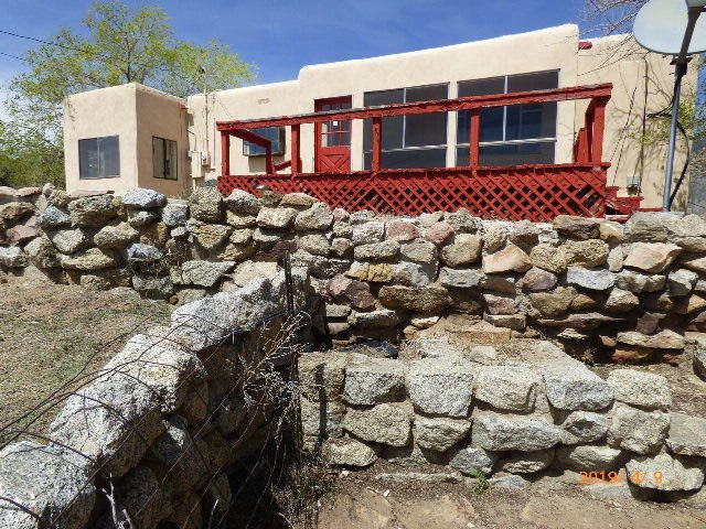 VIEWS, VIEWS VIEWS.  If it is serenity and mountain living you are looking for, and only a MINUTES from Albuquerque, well here it is. This home has a new roof but does need some TLC, and some remodeling that was started but needs to be finished, but with your special touch this could be good investment. Seller is motivated and will entertain all offers.