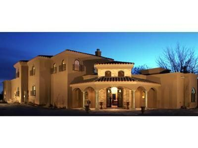 Stunning Tuscan masterpiece! Parade of Homes winner.  In heart of Los Ranchos. Private outdoor entertaining boasts pool with raised spa, lake with numerous koi, generous grounds for additional buildings,  Delightful master overlooking rear garden with enormous snail shower, jetted tub, double sinks and oversized walk in closet.  Truly remarkable property.