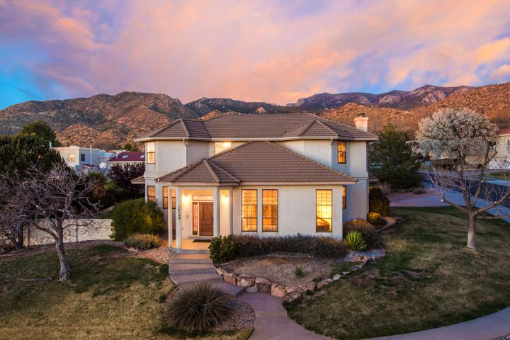 Immaculate custom home located in the FOOTHILLS!  Located on a corner lot, this beauty offers 4 Bedrooms, two living areas, formal dining, and kitchen with tons of storage. Large owner's suite with Views. Master bath has updated flooring and spa tub. Awesome deck that is accessible from top floor offering fabulous Sandia Views.  High Ceilings throughout, , 2 furnaces, 2 evap coolers, central Vac, and water softner. Park like backyard with covered patio, and oversized two car garage with storage and workbench. Located close to I-40, Sandia Labs, and Kirtland AFB. Pride of ownership throughtout.