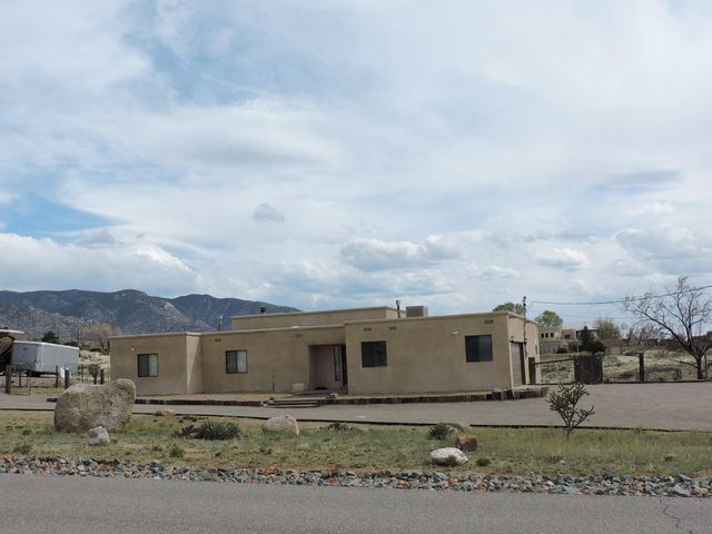 Views, views and more views! You can see the Sandia's, the Manzanos and the Jemez mountains from this amazing property! Newly installed roof with a transferable warranty. Lovely foyer with natural travertine tile flooring.  Enjoy this comfortable 4-bedroom home with 3 full bathrooms, extra large garage (548 +/- square feet) extra large walk in closets and a guest/in-law suite! Neutral colors throughout are ready for your personal touch!  The lot is large enough for equestrian and is animal friendly. Did we tell you about space for RV parking?  It has easy access and egress with a large circular driveway.  There is so much to see, this is a home to remember! Offer now!