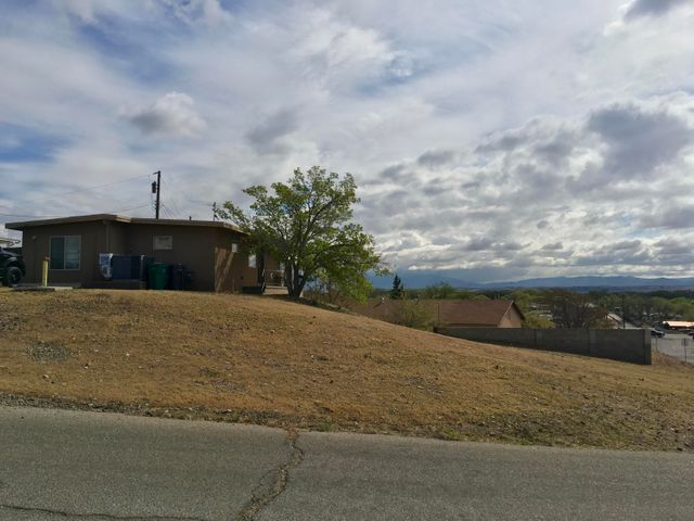 Bring your investors or rehab loans.  This home has great potential.  Newer windows, stucco, refrigerated air and water heater.  Home needs some roof repairs and drywall repairs.  Huge bonus area could be converted to heated square footage adding a few hundred square feet to home.
