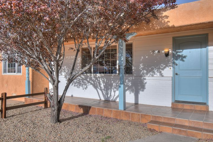 Newly updated Pueblo Alto gem! This home is just 3 min to Nob Hill and boasts all the luxury of updates along with charm like the original Harwood floors. 3 total bedrooms, plus an office or 4th bedroom. Master suite is brand new and on a split floor plan! Relax in your master suite with glass tiles and gorgeous barn door that adds ultimate style. The kitchen is the ultimate beauty with quartz countertops and all stainless steel. Alley access to the large back yard, perfect for a carport or garage! Cute mudroom off back door allow for ultimate organization. Brand new TPO roof and swamp cooler as well! Come call this one yours and enjoy all the surrounding Nob hill and Uptown areas have to offer!