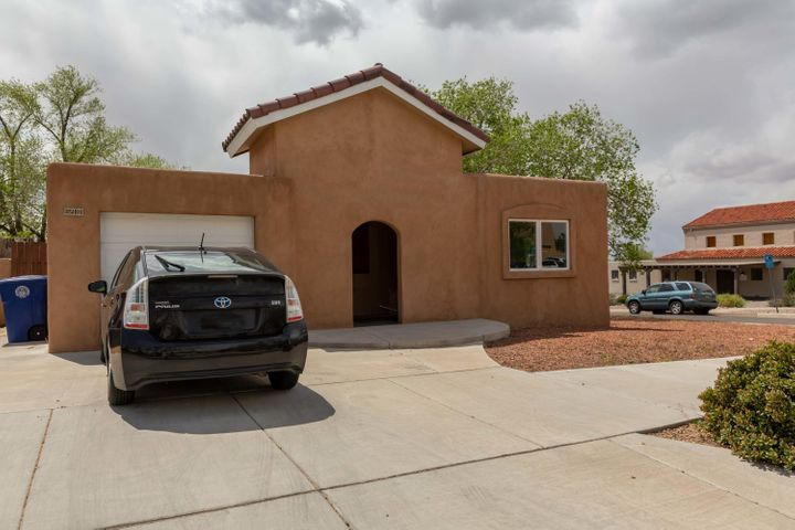 Beautiful home with wood floors.  Two living areas and an open kitchen with eating area.  Enjoy the outdoors under the covered patio that's perfect for entertaining. Just two blocks from Presbyterian Hospital!