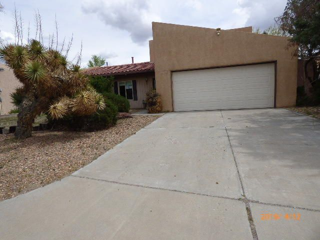 Located in the Country Club area. This home has lots of potential with your special touch. This home features a roomy living area with a custom wood burning fireplace. The back yard, backs to the old Rio Rancho golf course.