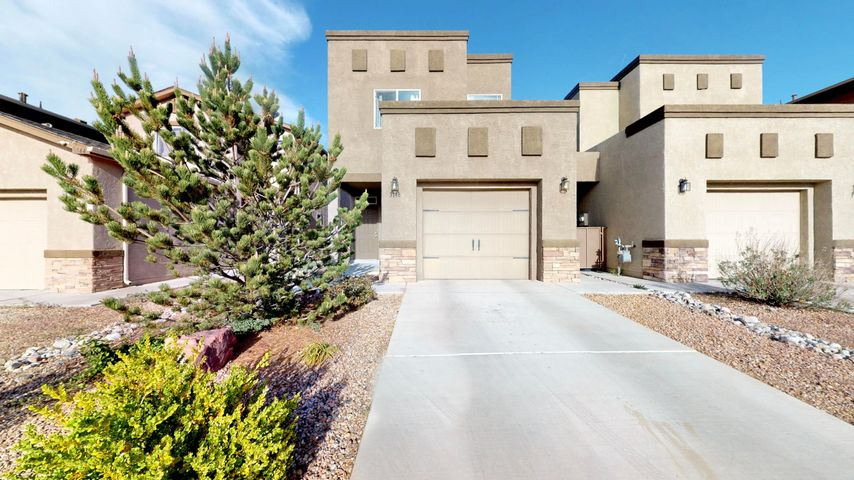 DR Horton Townhome, Build Green New Mexico silver level, tankless water heater, 92% efficient furnace, refrigerated air, tile floors, birch cabinets, stainless steel side by side refrigerator, range, microwave and dishwasher. washer and dryer also included.