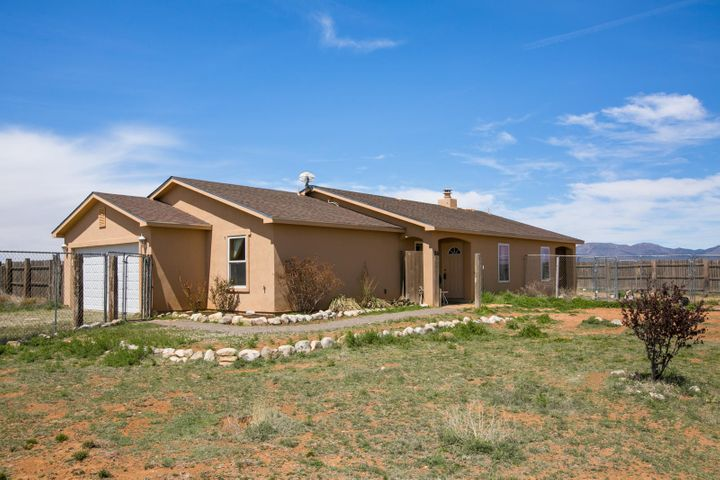 Beautiful Country Home on over 13 acres with all the amenities you need including a 1500 sq ft fully insulated garage/workshop/RV garage, 7 acres of fenced pasture, loafing shed with tack room, and separate fenced areas for pets.  The home includes an open living room with fireplace, dining room and perfect sized kitchen with newer appliances including sink, dishwasher, 5 burner gas stove and microwave.  Recent upgrades also include New water softener, water heater, whole house filter, and reverse osmosis system.  This home is a must see!