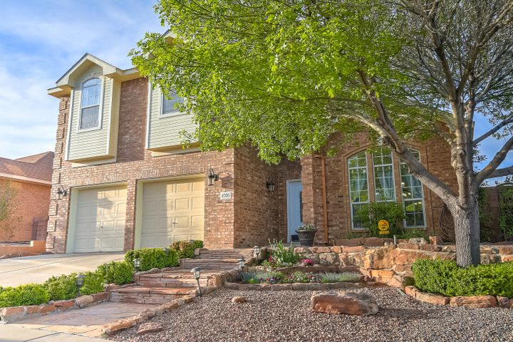 UPDATED BRICK BEAUTY w/ Great MOUNTAIN VIEWS. Newer Everything; Lighting, Plumbing, Hardware, Carpet, Tile, 2 LIVING AREAS w/ Vaulted Ceilings & Skylights, plus a Loft,  OPEN FLOOR PLAN. Gourmet Kitchen w/ New Cabinets, Granite, & Stainless Steel Appliances Open to the Family Room w/ a Cozy Gas Log Fireplace. Oversized Tile thru-out the Kitchen & Living Areas, Lots of Natural Light. MASTER BEDROOM/LUXURIOUS BATH ON THE FIRST FLOOR w/ a Garden Tub w/ Floor to Ceiling Tile, His/Hers Sinks, Granite Vanities, Oversized Custom Shower. Large Bedrooms w/ Walk In Closets. REFRIGERATED AIR, Enjoy your Private Backyard with a Sparkling Gunite Pool, Hot Tub, Outdoor Kitchen w/ Stacked Stone and Granite plus a Grassy Area for the Kids & the Puppies. Close to Restaurants and Shopping. MOVE IN READY!