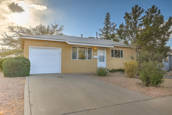 Wonderful recently updated NE Heights home.  Home Features - Remodeled kitchen with new cabinets, stainless steel appliances and new counter tops, hardwood floors, spacious closets, updated energy efficient windows, 1 car garage with work bench and large backyard with covered patio and mature trees.