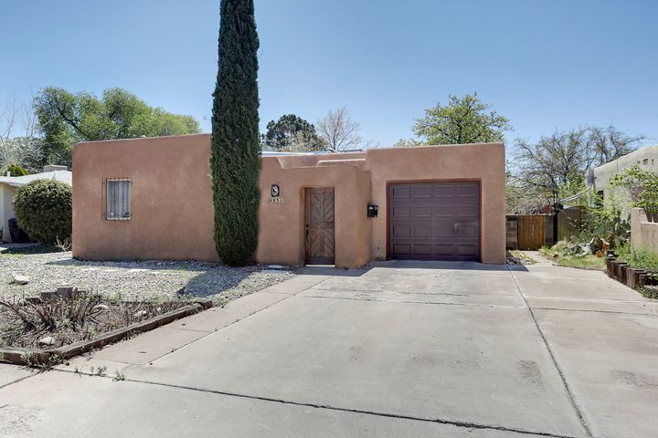 This charming home is the south UNM area will not last long. New roof, Refrigerated Air, Doublepane Windows, Private Patio In Front, Covered Deck In Large Private Back Yard, Refinished Hardwood Floors, Saltillo Tile, and a Large Sunroom/Den area. A MUST SEE!!!