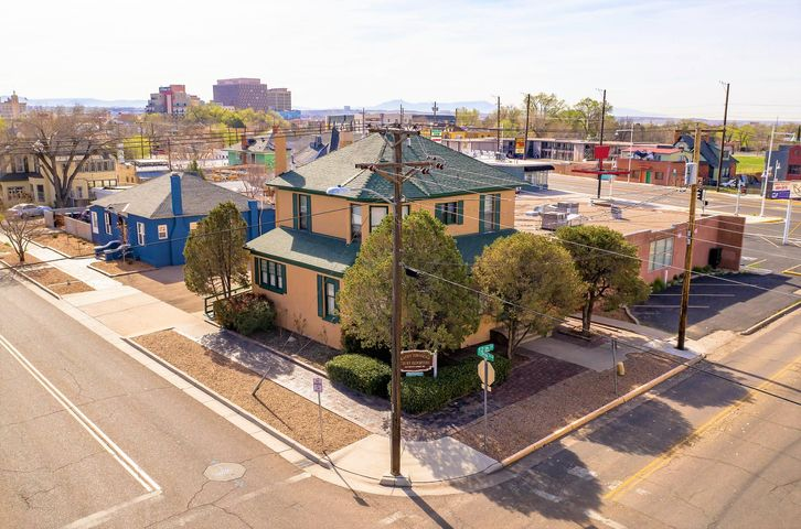 On the market for the first time in over twenty years, this is a unique opportunity to own a piece of Albuquerque's history. This beautiful, light-filled property was built in 1911 as a single family residence and in more recent times has been lovingly converted into a functional, professional office. It is situated over two floors (plus a functioning basement) on a large, tree-lined corner lot with onsite parking. This could be the ideal opportunity for a live/work user or if someone wishes to bring it back to its original use as a residence.The building currently comprises a combination of open work areas, conference rooms and private offices as well as a restroom on each floor, a generous sized break area and a welcoming waiting area complete with fireplace.
