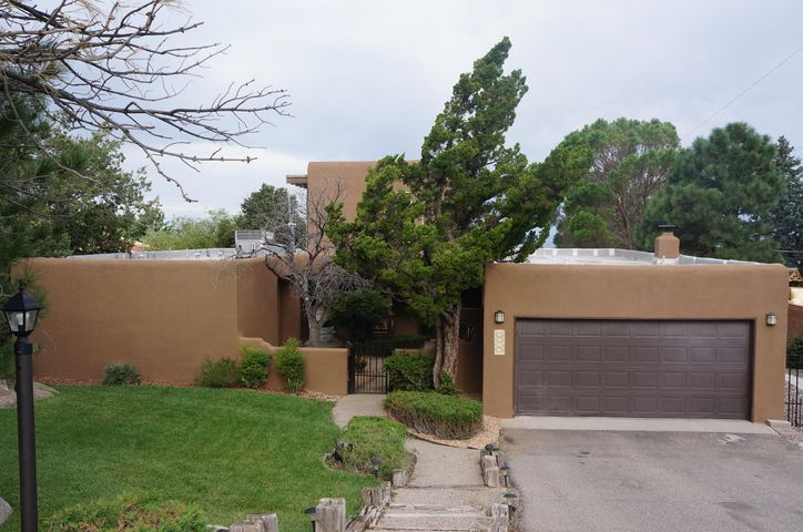 Enjoy spectacular views from this Pueblo style home in the Glenwood Hills Neighborhood. Close to mountains, very quiet. Recently updated. Refrigerated air. New windows, new TPO roof in 2017 , flooring and landscaping. Featuring large living/dining room, family room w/kiva fireplace, beam ceilings, 4 bedrooms, gourmet kitchen with granite countertops & stainless appliances. Built in book shelves, entertainment center, desk, walk in closets, ceiling fan. Oversized, landscaped lot w/vinyl pool, outdoor fireplace, large patio plus front courtyard.