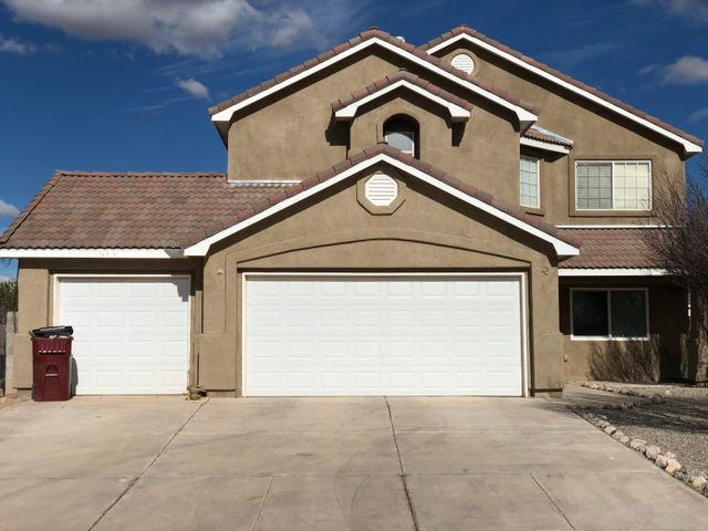 Price reduced on this Astonishing 4 bedroom, 2.5 bath home! This home is over 2200 square feet, and completely ready for move in!  All inspections and repairs have been completed! Enjoy features such as stainless steel appliances, BRAND NEW counter tops just put in, BRAND NEW stucco just done, beautiful hardwood floors, fireplace, and an oversized 3-car garage. Take in the beautiful views of the mountains from the private balconies. Relax in the gorgeous backyard that includes lush grass, a lovely rose garden, and a separate dog run.  Located close to the city, and only 30 minutes from Albuquerque, this is definitely a home worth seeing!