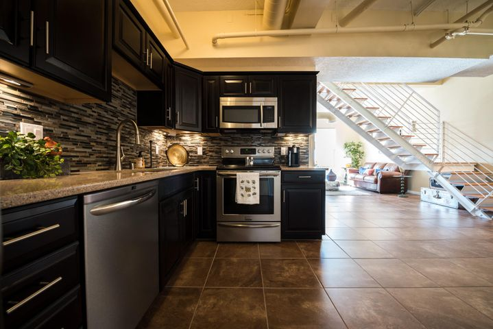 Located in the heart of downtown in a secure, key card access building. At approximately 1466 sq feet, this 2 story unit is beautifully appointed with modern high end fixtures, lighting, and materials. The state of the art designer kitchen features gourmet style stainless steel appliances and sleek custom cabinetry. A dramatic half bath is located on the first floor. Follow the steel and wood staircase into the 2nd floor where you'll discover a sanctuary retreat in the expansive bedroom, huge walk in closet and spa style master bath. Oversized guest bedroom with south views. Access to the 4,000+ sqft rooftop deck with expansive panoramic views of the city and mountains!!! garage parking optional, with a direct 5th floor garage access! hurry hurry Owner will finance, many yrs, great terms!