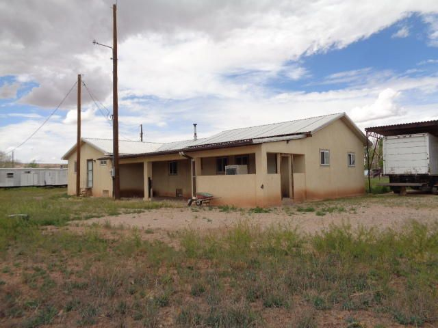 Quiet Ranchette on 2 parcels of property totaling 3.33 acres.  This 2 bedroom home is a single-wide with large additions and thermal windows throughout.  There is a cozy living room and huge den/rec room.  Washing machine in bathroom 2.  Heat is supplied by wood stove and pellet stove which Seller wants to keep.  30 x 91 covered haybarn/carport is over 12 feet tall.  Two stalls with frost free water.  Additional single-wide on property is used for storage.